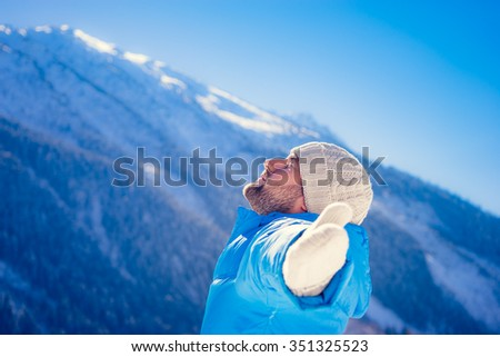 Freedom concept winter holiday vacation mountain man - stock photo