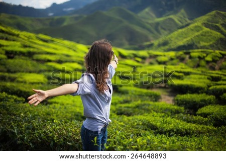 freedom girl in mountains on tea plantation - stock photo