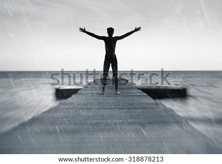 Freedom in nature concept - free happy man in the rain - stock photo