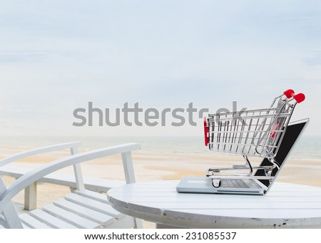 Freedom shopping on the beach - stock photo