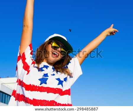 Freedom woman happy and free open arms on highest floor. Beautiful joyful elated woman looking up smiling by the positive during summer holidays vacation. Pretty multiracial brunette Caucasian girl. - stock photo