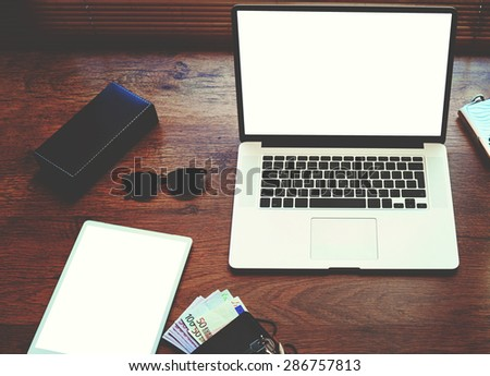 Freelancer needs mock up on wooden table in home interior, electronic business and distance work concept, laptop computer and digital tablet with white blank copy space screen and accessories lying - stock photo