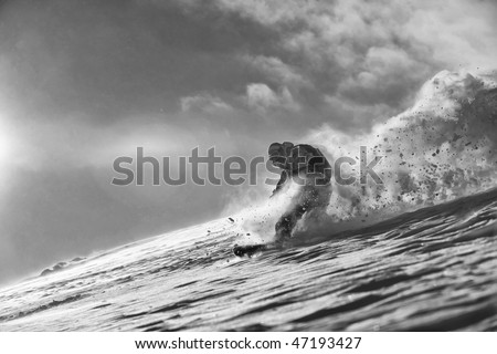 freestyle snowboarder jump and ride free style  at sunny winter day on mountain - stock photo