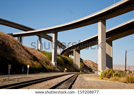Freeway Overpasses and Train Tracks - stock photo
