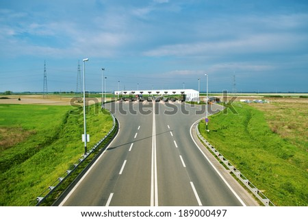 Freeway pay tolls in the distance - stock photo
