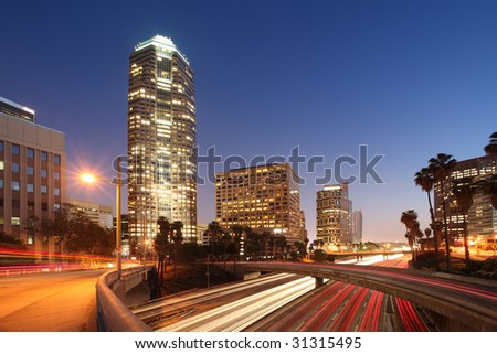 Freeway traffic in downtown Los Angeles at twilight. - stock photo