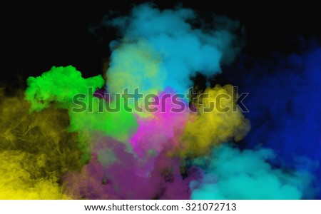Freeze motion of colored dust explosion - India, Holly - stock photo