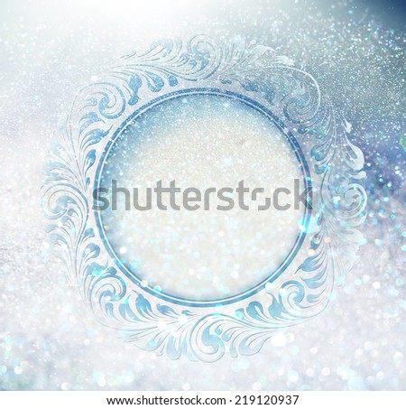 Freeze ornament over snow sparks. - stock photo