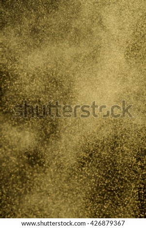 Freezed dust of eye shadows in background. Massive explosion of beauty product in the air. Weightless atmosphere. Shiny cosmetics. - stock photo