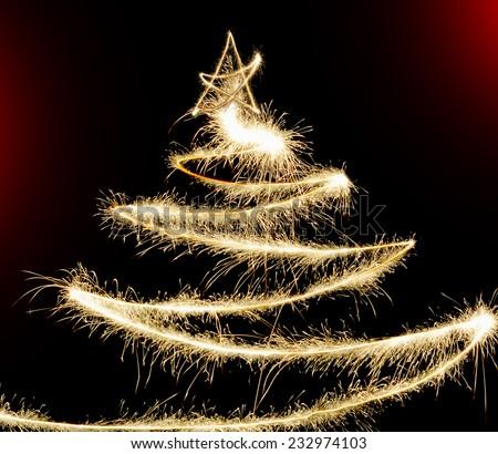 Freezelight Sparklers Christmas tree on black background - stock photo