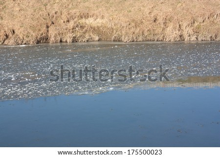 freezing river with crushed ice - stock photo