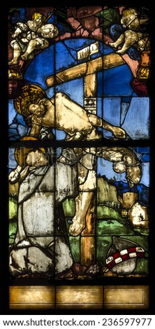 Freiburg, Germany - 22 June 2014 : Stained glass in german church. Scenes from the life of Jesus Christ : Jesus is taken down from the cross - stock photo