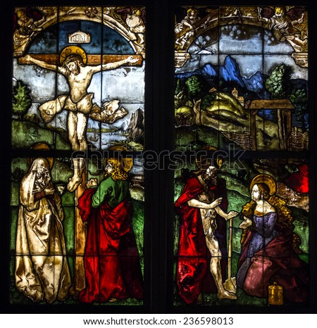 Freiburg, Germany - 22 June 2014 : Stained glass in german church. Scenes from the life of Jesus Christ : Jesus on the cross. - stock photo
