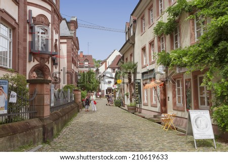 FREIBURG IM BREISGAU, GERMANY - AUGUST 6, 2014: Old town street in Freiburg, a city in the south-western part of Germany in the Baden-Wurttemberg state. - stock photo