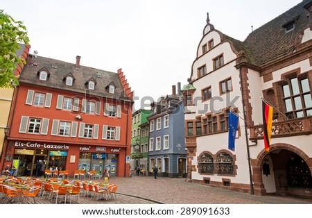 FREIBURG IM BREISGAU, GERMANY - MAY 1, 2013: Historical buildings at Rathausplatz (Town hall square) in Freiburg im Breisgau city, Baden-Wurttemberg state, Germany - stock photo