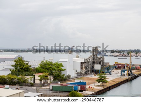 Freight and shipping at a manufacturing plant at a coastal harbor - stock photo