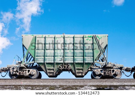 freight car over blue sky - stock photo