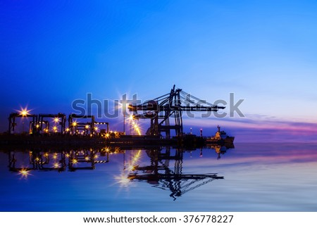 Freight dock of container crane at night - stock photo