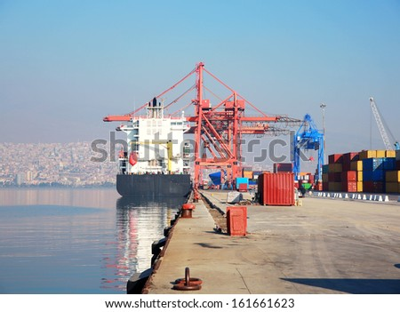 Freight ship moored in harbour - stock photo