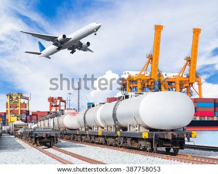 Freight train for oil and fuel transport and cargo plane and container cargo freight ship with working crane loading bridge in shipyard for logistic import export background - stock photo