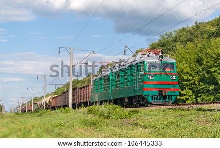 Freight train hauled by electric locomotive. Ukrainian railways - stock photo