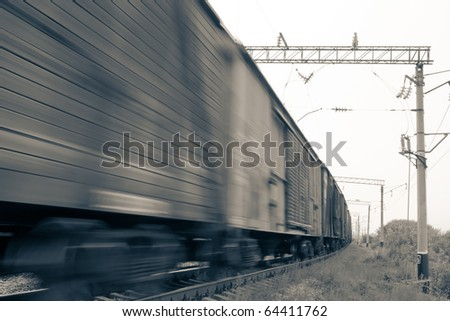 Freight train in motion - stock photo