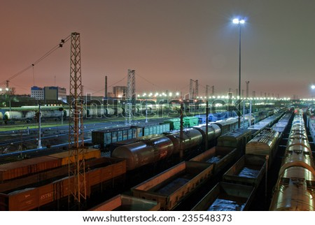 Freight train station at night - stock photo