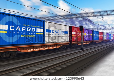 Freight train with color cargo containers passing railway station in winter with motion blur effect - stock photo