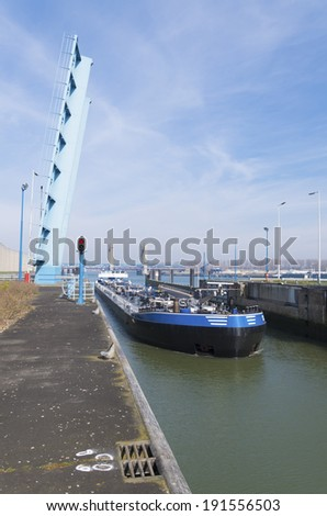 freighter entering a sluice in the rotterdam harbor area - stock photo