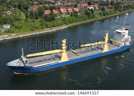 freighter on Kiel Canal - stock photo