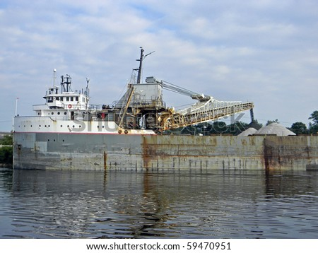 freighter unloading coal - stock photo