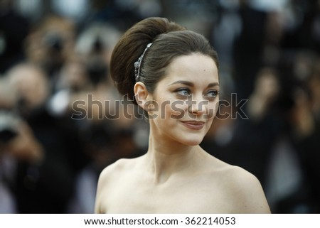 French actress Marion Cotillard leaves after the screening of 'De Rouille et D'Os' (Rust and Bone) presented in competition at the 65th Cannes film festival on May 17, 2012 in Cannes. - stock photo