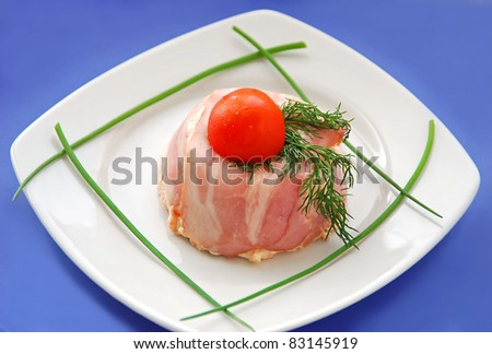 French appetizer - pate, terrine with bacon and cream on blue background - stock photo