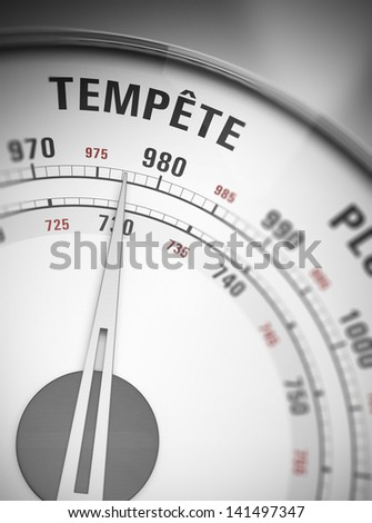 French barometer with needle pointing on storm. - stock photo