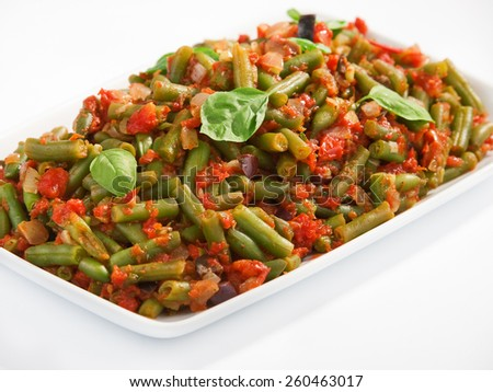 French beans and tomato casserole in large baking dish - stock photo