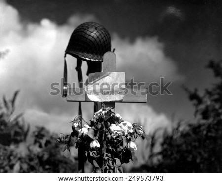 French civilians' tribute to an American soldier who died during the fighting in Carentan, France. The sign reads 'Mort pour la France', June 17, 1944. Normandy Campaign, France, World War 2. - stock photo