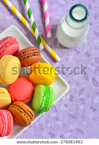french colorful macarons and milk - stock photo