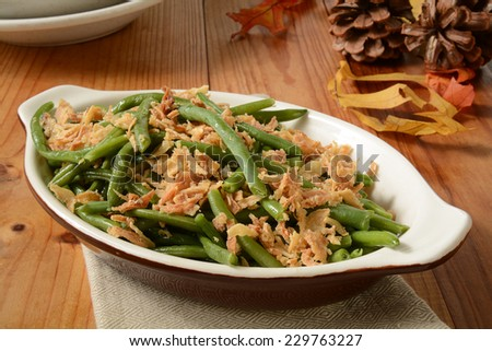 French cut green beans with crispy fried onions in a small casserole dish, a traditional holiday food - stock photo
