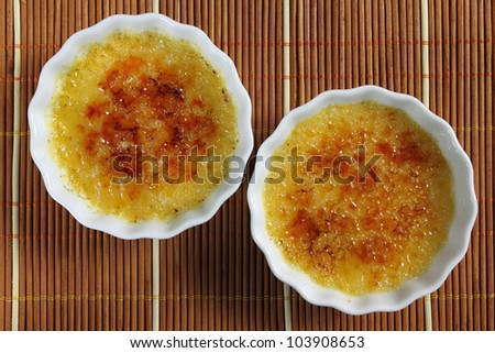 French dessert - creme brulee. Sweet caramelized custard. - stock photo