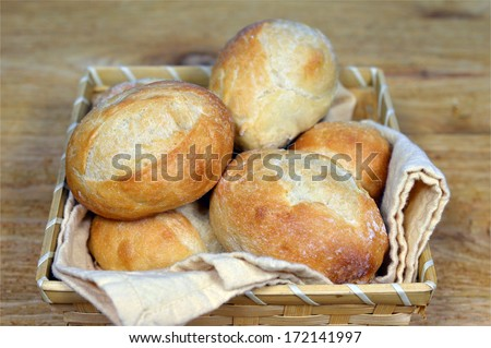 French Dinner rolls in the basket on the table - stock photo