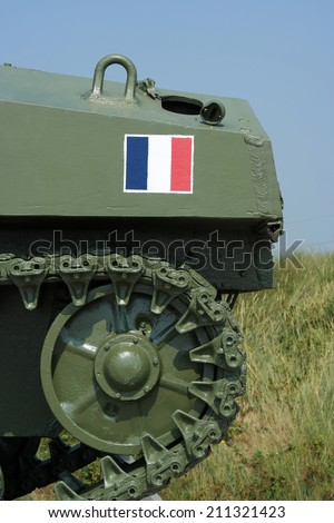 French flag at Second World War Sherman tank, a memorial of the french 2nd armored Division at the D-day landing site at Utah Beach, Normandy, France - stock photo