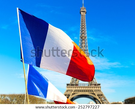 French flag waving in Paris, France - stock photo