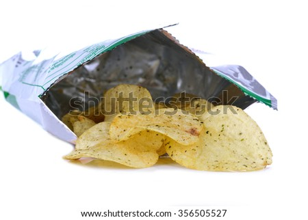 French fries in a plastic bag on a white background. - stock photo