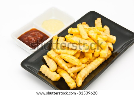 French fries in black plate on white background - stock photo