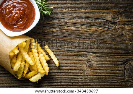 French fries over old wooden table. Top view - stock photo