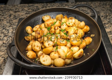 French fries potato wedges in the pan - stock photo