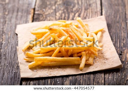 French fries potatoes on wooden table - stock photo