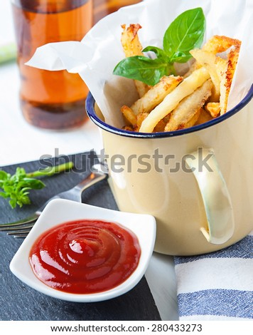 french fries served on vintage cup with ketchup sauce - stock photo
