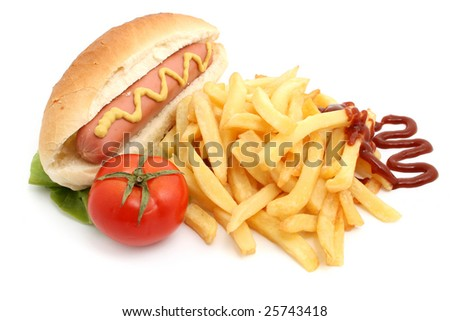 french fries, tomato and hot dog - stock photo