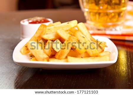 French fries with basil and ketchup - stock photo